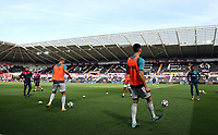 Swansea players warm up before kick off during the Premier League match between Swansea City and Watford at The Liberty Stadium, Swansea, Wales, UK. Saturday 23 September 2017