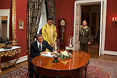 Oslo, Norway - December 10, 2009 -- United States President Barack Obama and First Lady Michelle Obama sign the guest book at Slottet Royal Palace of Norway in Oslo, Norway, Thursday, December 10, 2009..Mandatory Credit: Pete Souza - White House via CNP
