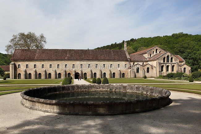 Fontenay Abbey, Marmagne, Cote d'Or, France. This Cistercian abbey was founded by Saint Bernard of Clairvaux in 1119, built in the Romanesque style. The abbey itself housed 300 monks from 1200, but was sacked during the French Revolution. The southern transept arm is extended by a vast quadrangular area housing the Monks' Room which links the religious and domestic buildings. It is backed by formal gardens with a round pond leading to the monks' medicinal and herb garden. The church can be seen on the right. Picture by Manuel Cohen