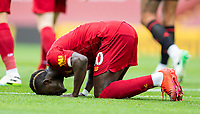 5th July 2020, Anfield, Liverpool, England;  Liverpools Sadio Mane kneels to celebrate after scoring his goal in the Premier League match between Liverpool and Aston Villa at Anfield in Liverpool