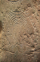 """Close up of prehistoric  petroglyphs, rock carvings, of a geometric design carved by the the prehistoric Camuni people in the Copper Age around the 3rd milleneum BC, Stele """"Bagnolo 2"""" found in 1972 from Malegno near Bangnolo Ceresolo. Museo Nazionale della Preistoria della Valle Camonica ( National Museum of Prehistory in Valle Cominca ), Lombardy, Italy. Grey Art Background"""