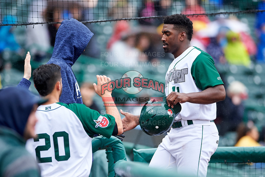 Fort Wayne TinCaps Dwanya Williams-Sutton (11) is congratulated by teammates after scoring a run during a Midwest League game against the Kane County Cougars at Parkview Field on May 1, 2019 in Fort Wayne, Indiana. Fort Wayne defeated Kane County 10-4. (Zachary Lucy/Four Seam Images)