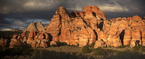 The sun sets on the sandstone rock formations in Kolob Terrace at Zion National Park, Utah