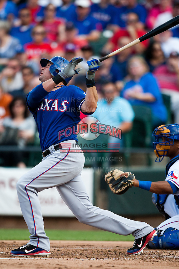"Texas Rangers designated hitter Michael Young #10 at bat during the MLB exhibition baseball game against the ""AAA"" Round Rock Express on April 2, 2012 at the Dell Diamond in Round Rock, Texas. The Rangers out-slugged the Express 10-8. (Andrew Woolley / Four Seam Images)."