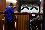 BAGHDAD, IRAQ: Hussein shoots bottles with an air rifle at an amusement park in central Baghdad...On January 22nd, 2012, an IED (Improvised Explosive Devise) detonated near an Iraqi Army base in Fallujah. Hussein Jamil Abdullah, a 28 year-old soldier from Baghdad was nearby when the explosive discharged, knocking him to the ground. Hey lay there for half an hour, his right leg in an jerry-rigged tourniquet made from a headscarf, before he was taken to hospital...Gangrene set in almost immediately and the doctors at Fallujah General Hospital had to amputate his leg. He was then moved to Adnan Hospital, the military medical center, but the care Hussein received was terrible. His bandage wasn'.t changed for two days and fearing that gangrene would set in a second time his family moved him to Kerkh Hospital, which they had to cover the costs themselves, as the army refused to pay...As soon as he was wounded, the Army cut Hussein.s salary in half: from $500 a month to $250, which is less than he can live on. His brother, Ali, has given up his work as a barber to take care of him, and his two other brothers, Abbas and Hassan, now take care of the family...Before he was wounded, Hussein, was to be engaged to his fiancée, Hind and he had even bought and furnished a room in preparation. But, after the explosion, Hind.'s father refused to allow them to marry, saying that they can.t do so until Hussein gets a prosthetic leg...In the summer, a selection of photographs were published online and caught the attention of an NGO worker in Baghdad who arranged for Hussein to have a prosthetic leg fitted...Once he had his prosthetic leg, Hussein married Hind.