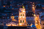 Bolivia, Sucre, view over red roofs of historic center and cathedral at dusk