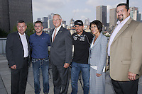 August  2012 File Photo - Montreal (Quebec) CANADA -  François Dumontier, Octane, Nascar driver  Justin Allgaier (L) and Alexandre Tagliani (R) pose with Mayor Gerald Tremblay (M) ,Manon Barbem,M. Joe Balash, NASCAR at Montreal City Hall on August 16 2012.<br /> <br /> Les coureurs automobile de NASCAR  Justin Allgaier (G), Alexandre Tagliani (D) pose avec le Maire Gerald tremblay (M) a l'Hotel de Villle de Montreal, le 16 aout 2012.