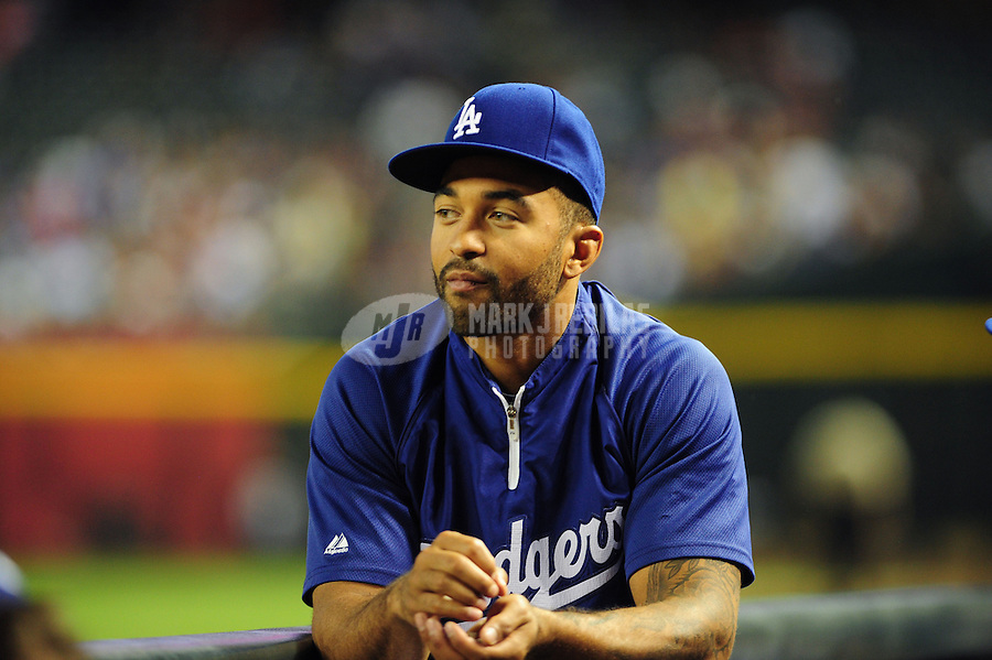 May 21, 2012; Phoenix, AZ, USA; Los Angeles Dodgers injured outfielder Matt Kemp watches from the dugout in the fourth inning against the Los Angeles Dodgers at Chase Field.  Mandatory Credit: Mark J. Rebilas-