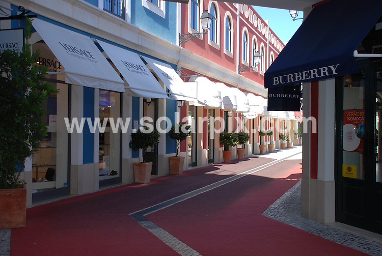 "**ALL ROUND PICTURES FROM SOLARPIX.COM**.**WORLDWIDE SYNDICATION RIGHTS**.Superb design and rock bottom prices makes this a must visit for those who love ""retail therapy"", major brands, and a bargain. This designer outlet is claimed to be the largest in Europe with over 200 shops. Visit between Mondays and Fridays during the day and it's virtually empty as Portuguese shoppers tend to prefer the weekend.  It's located in the town of Alcochete south of the river in Lisbon, a few kilometres from the first exit off the Vasco da Gama bridge...This pic: Freeport...JOB REF:   4330 PPL        DATE:.**MUST CREDIT SOLARPIX.COM OR DOUBLE FEE WILL BE CHARGED* *UNDER NO CIRCUMSTANCES IS THIS IMAGE TO BE REPRODUCED FOR ANY ONLINE EDITION WITHOUT PRIOR PERMISSION*"