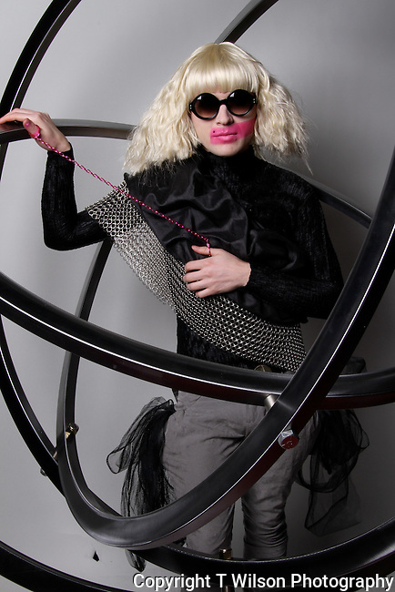 I give rock star photo shoots to Little Monsters on Lady Gaga's Monster Ball Tour.