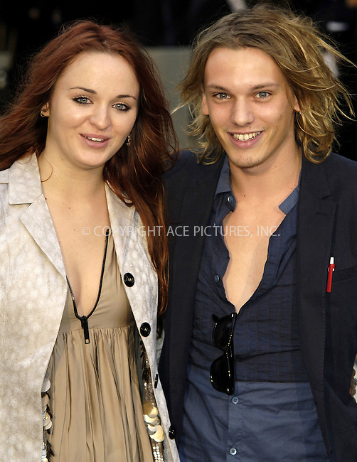 WWW.ACEPIXS.COM . . . . .  ..... . . . . US SALES ONLY . . . . .....September 22 2009, London....Jamie Campbell Bower and guest at the Burberry Spring/Summer 2010 show at London Fashion Week on September 22, 2009 in London....Please byline: FAMOUS-ACE PICTURES... . . . .  ....Ace Pictures, Inc:  ..tel: (212) 243 8787 or (646) 769 0430..e-mail: info@acepixs.com..web: http://www.acepixs.com