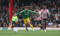 Preston North End's Callum Robinson and Brentford's Emiliano Marcondes<br /> <br /> Photographer Rob Newell/CameraSport<br /> <br /> The EFL Sky Bet Championship - Brentford v Preston North End - Sunday 5th May 2019 - Griffin Park - Brentford<br /> <br /> World Copyright © 2019 CameraSport. All rights reserved. 43 Linden Ave. Countesthorpe. Leicester. England. LE8 5PG - Tel: +44 (0) 116 277 4147 - admin@camerasport.com - www.camerasport.com