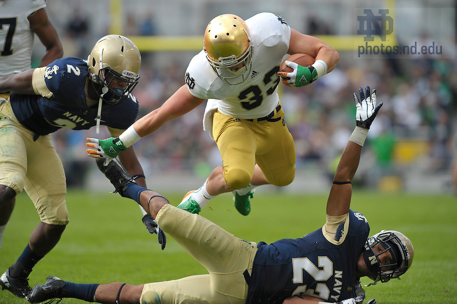Sep 1, 2012; Running back Cam McDaniel jumps over a Navy defender in the 50-10 win at Aviva Stadium. ..Photo by Matt Cashore/University of Notre Dame
