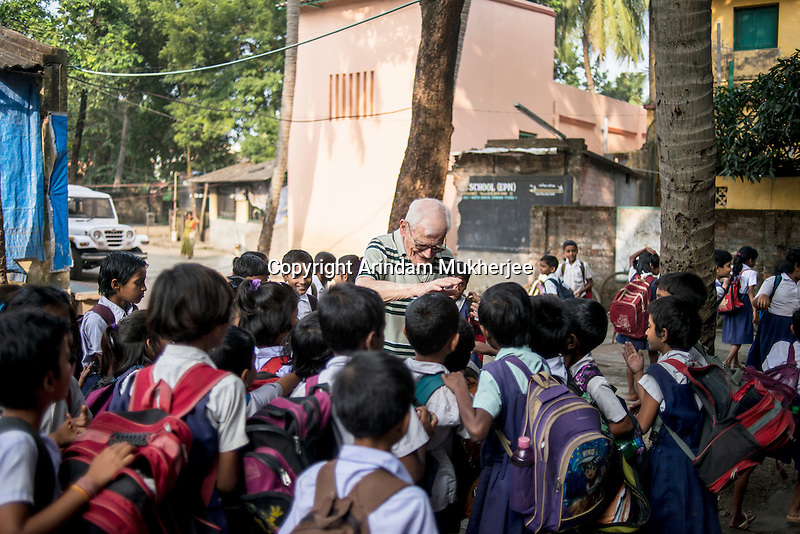 Father Laborde interact with the students at Ekpranta Nagar School. West Bengal, India, Arindam Mukherjee/Agency Genesis