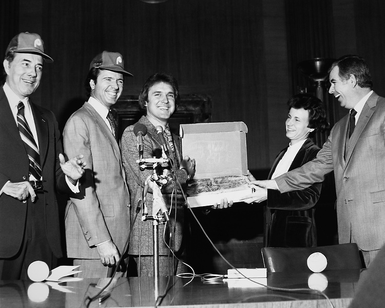 Sen. Bob Dole, R-Kans., Sen. H. John Heinz III, R-Pa., Tug McGraw, and Diane James Murphy, of National Beef for Kansas (where the steaks come from). (Photo by CQ Roll Call)