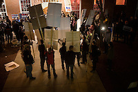 Occupy protesters gather outside a Rick Santorum campaign event at Jillian's, a bar in Manchester, New Hampshire, on Jan. 9, 2012.  Santorum is seeking the 2012 Republican presidential nomination.
