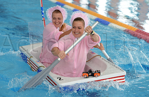20.09.2014. Wolfsburg, Germany.  Maike (L) and Janina from Xanten paddle during the European Bathtub Racing Championships in Wolfsburg, Germany. Teams from Austrian, Liechtenstein,Italy, Luxembourg, Switzerland and Germany took part in the competition.