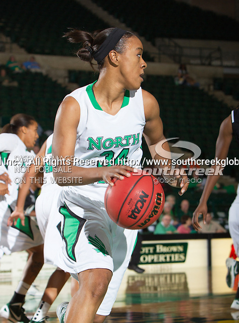 North Texas Mean Green guard Tamara Torru (34) in action during the game between the Troy Trojans and the University of North Texas Mean Green at the North Texas Coliseum,the Super Pit, in Denton, Texas. UNT defeats Troy 57 to 36.