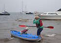 24/05/15<br /> <br /> A woman takes her pooch for a rainy paddle off the beach in Instow, North Devon,  as the bank holiday weekend weather takes a turn for the worse.<br /> <br /> All Rights Reserved - F Stop Press.  www.fstoppress.com. Tel: +44 (0)1335 418629 +44(0)7765 242650