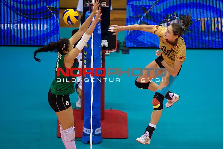05.10.2014, Pala Trieste, Triest<br /> Volleyball, FIVB Volleyball Women`s World Championship 2014, 2. Runde, Deutschland (GER) vs. Aserbaidschan (AZE)<br /> <br /> Block Odina Bayramova (Aliyeva) (#5 AZE) - Angriff Christiane F&uuml;rst / Fuerst (#11 GER)<br /> <br />   Foto &copy; nordphoto / Kurth