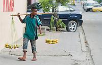 Street vendor offers fruit for sale in Dili, Timor-Leste (East Timor)