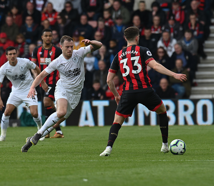 Bournemouth's Chris Mepham (right) under pressure from Burnley's Ashley Barnes (left) <br /> <br /> Photographer David Horton/CameraSport<br /> <br /> The Premier League - Bournemouth v Burnley - Saturday 6th April 2019 - Vitality Stadium - Bournemouth<br /> <br /> World Copyright © 2019 CameraSport. All rights reserved. 43 Linden Ave. Countesthorpe. Leicester. England. LE8 5PG - Tel: +44 (0) 116 277 4147 - admin@camerasport.com - www.camerasport.com