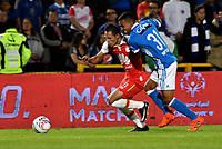 BOGOTA - COLOMBIA - 22 – 01 - 2018: Omar Bertel (Der.) jugador de Millonarios disputa el balón con Anderson Plata (Izq.) jugador de Independiente Santa Fe, durante partido entre Millonarios y el Independiente Santa Fe, por el Torneo Fox Sports 2018, jugado en el estadio Nemesio Camacho El Campin de la ciudad de Bogota. / Omar Bertel (R) player of Millonarios vies for the ball with Anderson Plata (L) player of Independiente Santa Fe, during a match between Millonarios and Independiente Santa Fe, for the Fox Sports Tournament 2018, played at the Nemesio Camacho El Campin stadium in the city of Bogota.Photo: VizzorImage / Luis Ramirez / Staff.