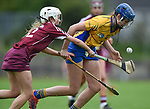Aine O Loughlin of Clare in action against Sinead Cannon of Galway during their Minor A All-Ireland final at Nenagh.  Photograph by John Kelly.