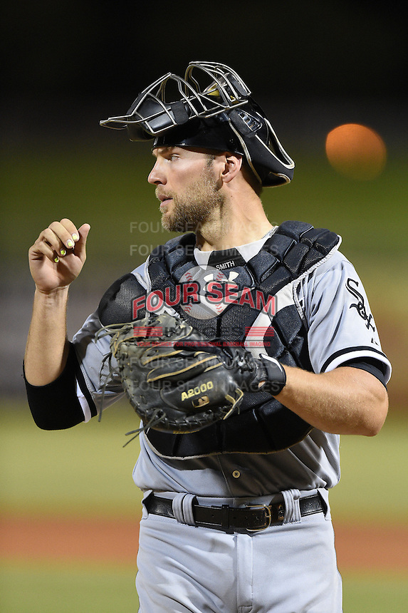 Glendale Desert Dogs catcher Kevan Smith (18) during an Arizona Fall League game against the Peoria Javelinas on October 14, 2014 at Surprise Stadium in Surprise, Arizona.  Glendale defeated Peoria 9-0.  (Mike Janes/Four Seam Images)