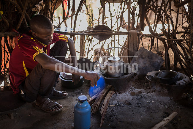A man boild water in his hut at the refugee camp of Daadab in Kenya, with a population estimated in 250,000 people. Created in 1992 to host people escaping the civil conflict in Somalia, the camp under the custody of United Nations grew with waves of people escaping from civil wars and droughts. Generations are born, grown and died in this camp, considered the second largest of the World