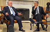 United States President Barack Obama (R) listens as Prime Minister Haider al-Abadi of Iraq makes remarks after a bilateral meeting in the Oval Office of the White House, April 14, 2015, in Washington, DC. The leaders discussed the strategic partnership between the two countries, support in fighting ISIL as well as commercial and cultural relations.       <br /> Credit: Mike Theiler / Pool via CNP