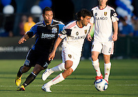 Javier Morales of Real Salt Lake dribbles the ball away from Arturo Alvarez of Earthquakes during the game at Buck Shaw Stadium in Santa Clara, California on March 27th, 2010.   Real Salt Lake defeated San Jose Earthquakes, 3-0.