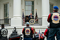 United States President Donald J. Trump, center, speaks from the Blue Room Balcony of the White House during a Rolling to Remember ceremony honoring the nation's veterans and prisoners of war/missing in action (POW/MIA) in Washington, D.C., U.S., on Friday, May 22, 2020. Trump didn't wear a face mask during most of his tour of Ford Motor Co.'s ventilator facility Thursday, defying the automaker's policies and seeking to portray an image of normalcy even as American coronavirus deaths approach 100,000. <br /> Credit: Andrew Harrer / Pool via CNP /MediaPunch