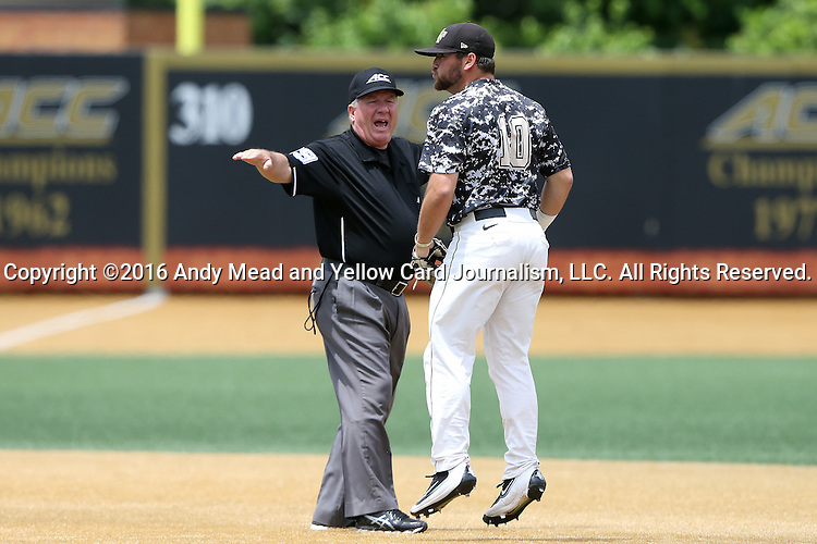 21 May 2016: Wake Forest's Nate Mondou (10) reacts to a call by second base umpire Tim O'Toole (left). The Wake Forest University Demon Deacons played the University of Louisville Cardinals in an NCAA Division I Men's baseball game at David F. Couch Ballpark in Winston-Salem, North Carolina. Louisville won the game 9-4.