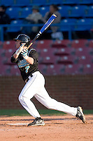 Taylor Motter #7 of the Coastal Carolina Chanticleers follows through on his swing versus the Wake Forest Demon Deacons at Wake Forest Baseball Park April 8, 2009 in Winston-Salem, North Carolina. (Photo by Brian Westerholt / Four Seam Images)