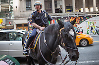 A NYPD officer on horseback is pictured in the New York City borough of Manhattan, NY, Monday May 12, 2014.