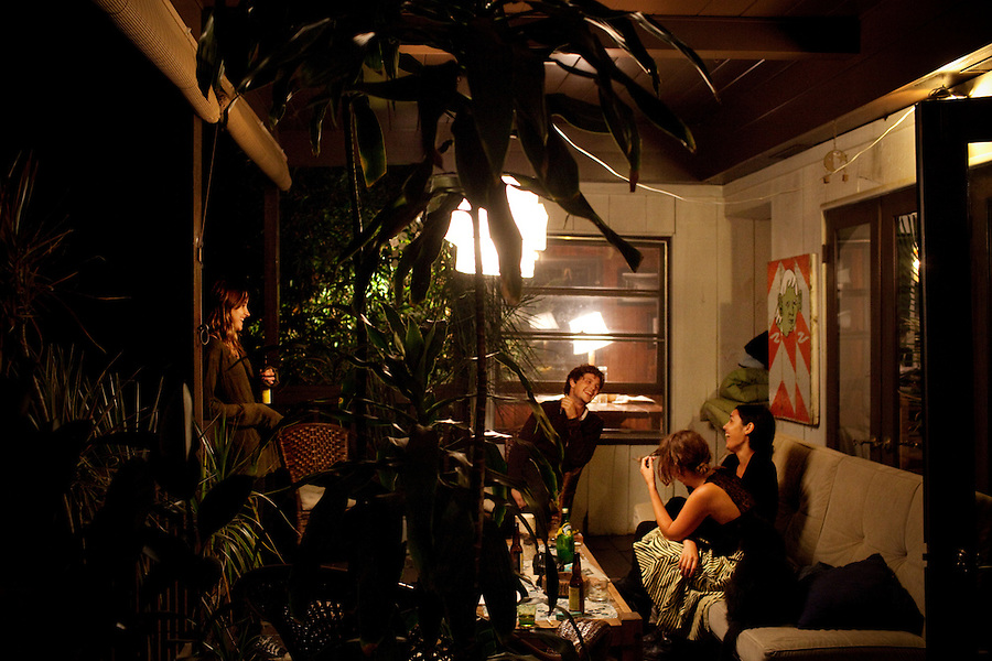 Los Angeles, California, August 1, 2009 - Moonrats guitarist, Nathan Thelen, center, chils with Warpaint guitarist/keyboardist, Theresa Wayman, left, guitarist Emily Kokal, nearest, and Jenny Lee Lindberg on the balcony of Thelen's home in the hills above Studio City. The two bands just finished a 10-day tour of the west coast.