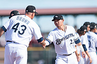 Peoria Javelinas second baseman Keston Hiura (23), of the Milwaukee Brewers organization, shakes hands with manager Daren Brown (43) during player introductions before the Arizona Fall League Championship game against the Salt River Rafters at Scottsdale Stadium on November 17, 2018 in Scottsdale, Arizona. Peoria defeated Salt River 3-2 in 10 innings. (Zachary Lucy/Four Seam Images)