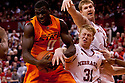 12 February 2011:  Oklahoma State Cowboys forward J.P. Olukemi #0 rips the ball away from Nebraska Cornhuskers guard Drake Beranek #31 during the first half at the Devaney Sports Center in Lincoln, Nebraska. Nebraska defeated Oklahoma State 65 to 54.