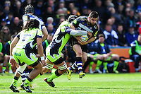 Rob Webber of Bath Rugby is tackled in possession. Aviva Premiership match, between Bath Rugby and Sale Sharks on April 23, 2016 at the Recreation Ground in Bath, England. Photo by: Patrick Khachfe / Onside Images