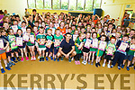 Ballyduff NS students, give a big welcome to Kerry footballer Shane Enright on his visit to the school on Thursday to raise the Blue Active Flag.