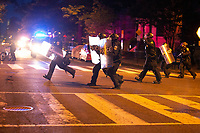 Police run to disperse protestors in Washington, D.C., U.S., on Monday, June 1, 2020, following the death of an unarmed black man at the hands of Minnesota police on May 25, 2020.  More than 200 active duty military police were deployed to Washington D.C. following three days of protests.  Credit: Stefani Reynolds / CNP/AdMedia