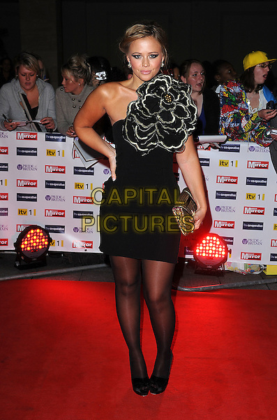 KIMBERLEY WALSH (Girls Aloud).The Pride of Britain Awards, Grosvenor House, Hotel, Park lane, London, England. .October 5th, 2009.full length black dress gold flower carrie corsage tights shoes peep toe bows clutch bag hand on hip kimberly one shoulder .CAP/BEL.©Tom Belcher/Capital Pictures.