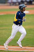 Xavier Macklin #13 of the North Carolina A&T Aggies hustles down the first base line versus the High Point Panthers at War Memorial Stadium March 16, 2010, in Greensboro, North Carolina.  Photo by Brian Westerholt / Four Seam Images