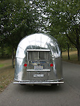 A rear shot of a Der Kleine Prinz Airstream sitting on the road.