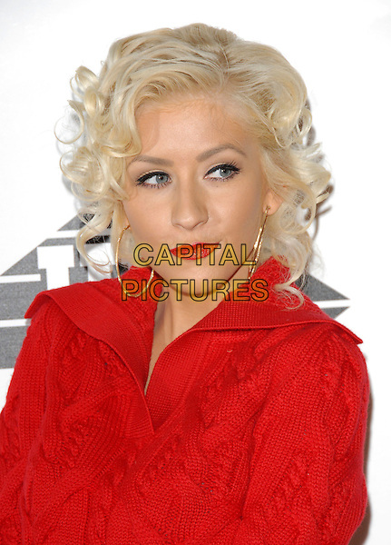CHRISTINA AGUILERA.The Justin Timberlake FutureSex / Love Sounds CD Launch Party held at Miauhaus Studios in Los Angeles, California, USA. .September 19th, 2006.Ref: DVS.headshot portrait red lipstick gold hoop earrings.www.capitalpictures.com.sales@capitalpictures.com.©Debbie VanStory/Capital Pictures