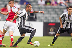 Juventus' player Roberto Pereyra breaks past South China's player Griffiths Ryan Alan during the South China vs Juventus match of the AET International Challenge Cup on 30 July 2016 at Hong Kong Stadium, in Hong Kong, China.  Photo by Marcio Machado / Power Sport Images