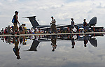 (Chicopee, MA, 07/15/18) Crowds are reflected in a puddle after an early morning shower while attending the Great New England Air and Space Show at Westover Air Reserve Base in Chicopee on Sunday, July 15, 2018. Photo by Christopher Evans