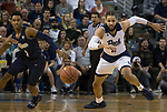 Nevada's Cody Martin (11) and Akron,s Loren Cristian Jackson (1) go after a loose ball in the first half of an NCAA college basketball game in Reno, Nev., Saturday, Dec. 22, 2018. (AP Photo/Tom R. Smedes)