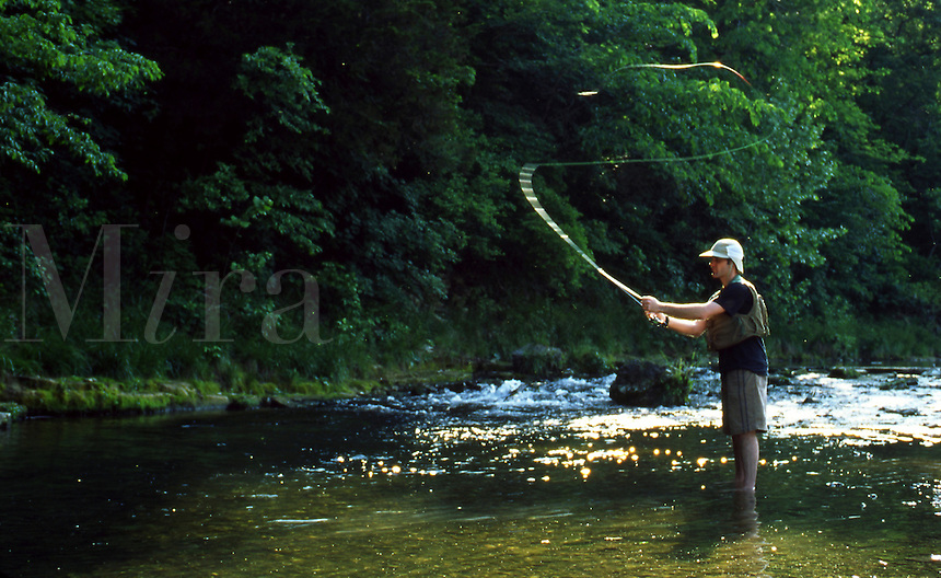 Man fly-fishing in Roaring River State Park , Missouri.